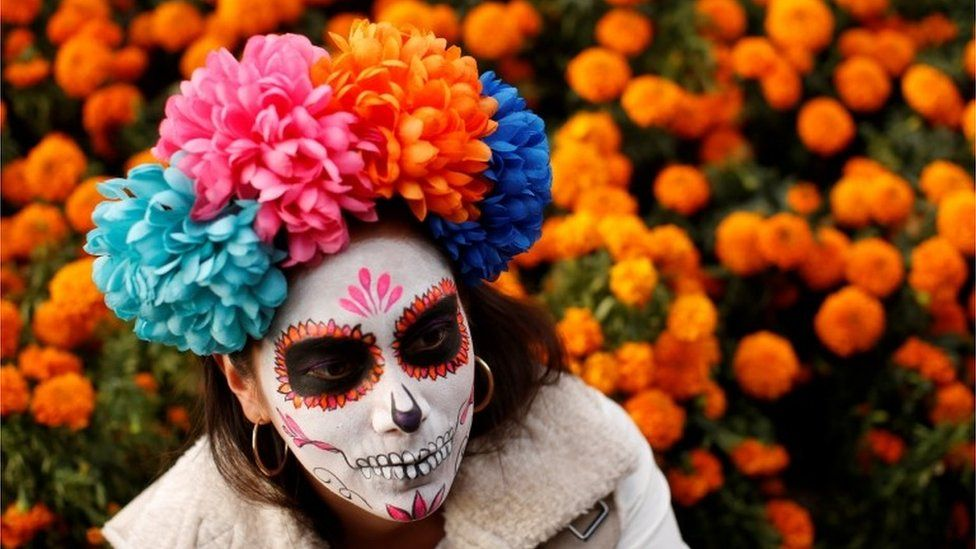 A woman dressed up as Catrina takes part in a Catrinas parade in Mexico City on 22 October 2017