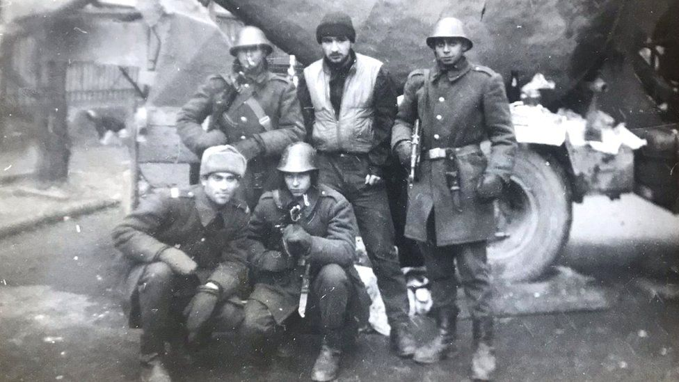 Traian Rabagia (centre, top) aged 19 in Bucharest, days after Ceausescu fled, spending time with some of his military service colleagues who days before he faced down in the streets
