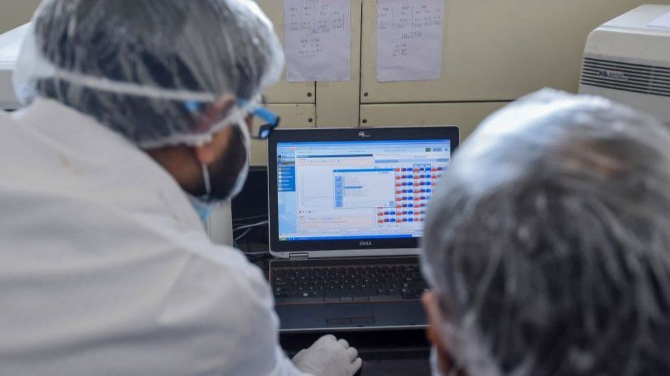 Employees of Dr Lal PathLabs, that provides diagnostic and health tests, check results of coronavirus tests at their lab during a government-imposed nationwide lockdown as a preventive measure against the COVID-19 coronavirus, in New Delhi on April 2, 2020.