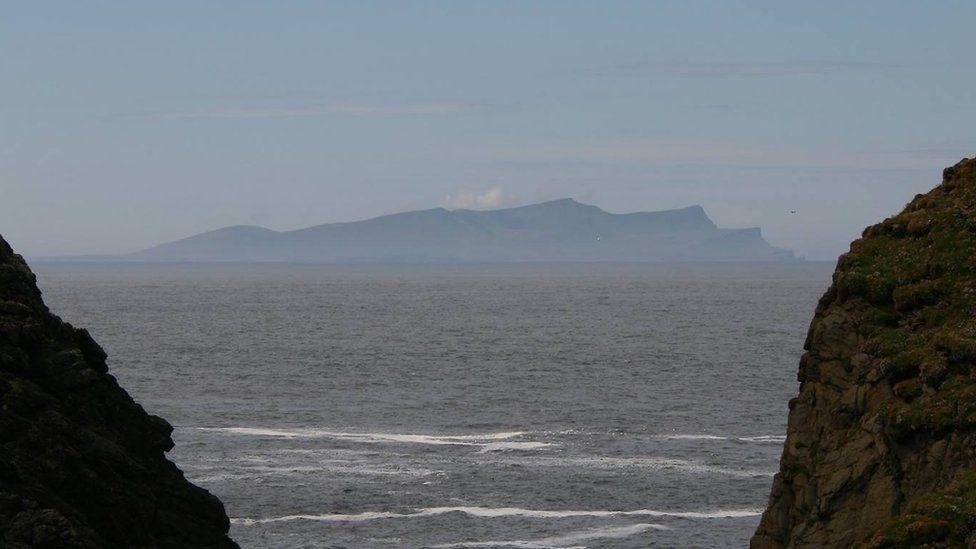 Foula seen between two cliffs