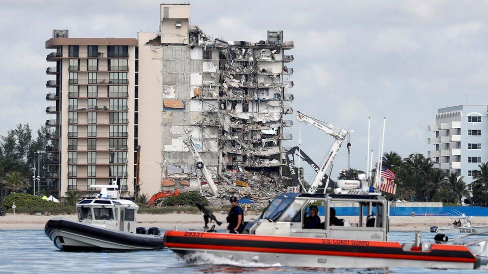 US Coast Guard and Miami-Dade Police patrol at the site of a partially collapsed residential building in Surfside, Florida