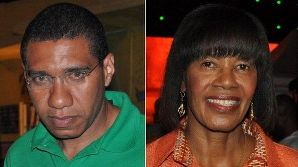 A file photo from 28 December 2011 shows Andrew Holness (left) and Portia Simpson Miller