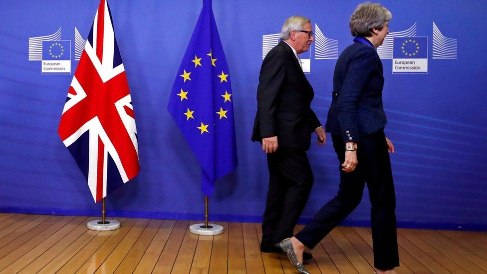 British Prime Minister Theresa May and European Commission President Jean-Claude Juncker leave for a meeting to discuss draft agreements on Brexit, at EC headquarters in Brussels, Belgium November 24, 2018.