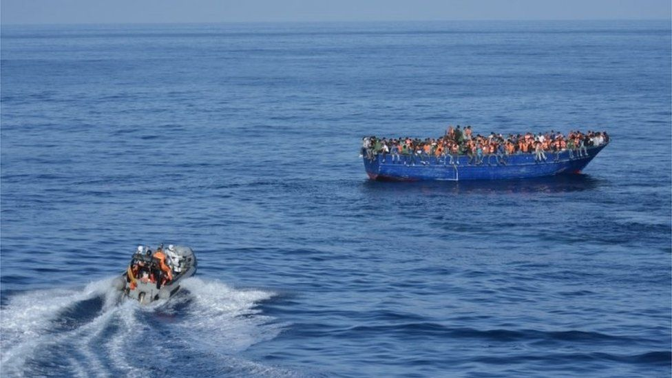 A picture provided by Spanish Ministry of Defence on November 5, 2015 shows Spanish rescuers approaching a boat with migrants off the coast of Libya.