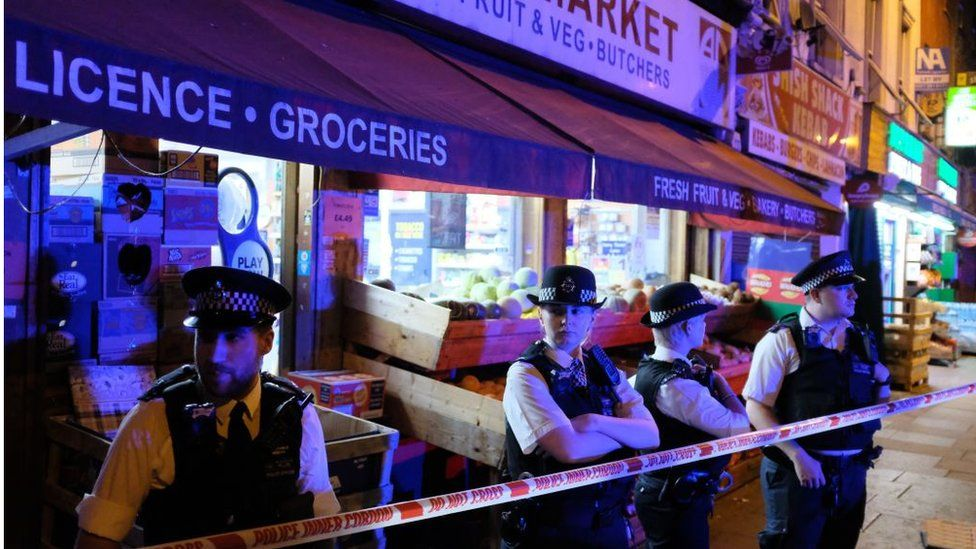 Police cordon off a street in the Finsbury Park area of north London after a vehicle hit pedestrians, on June 19, 2017