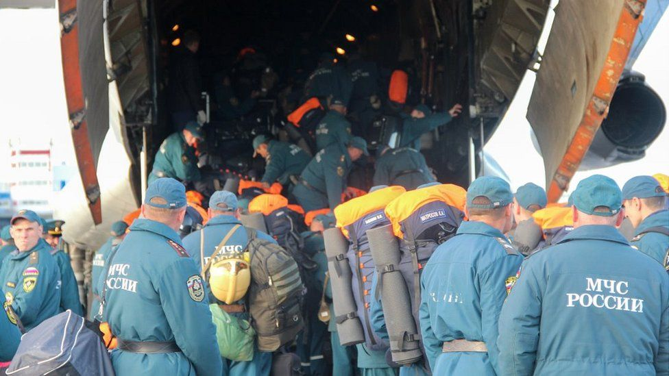Novosibirsk specialists boarding transport plane, 4 Jun 20