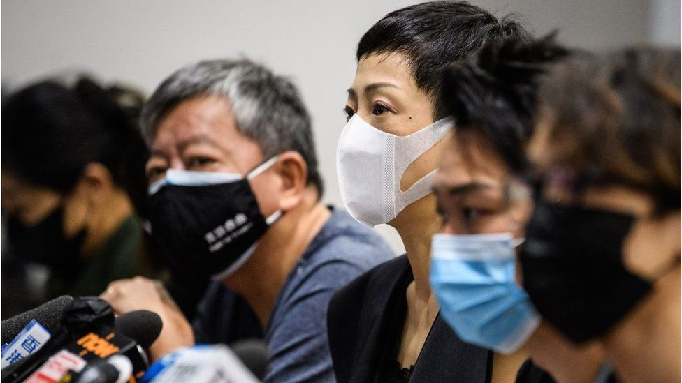 Tanya Chan (C) of the Civic Party, Jimmy Sham (2nd R) convener of pro-democracy organisation Civil Human Rights Front (CHRF) and other pro-democracy lawmakers and activists hold a press conference in a meeting room of the Legislative Council in Hong Kong on May 22, 2020.