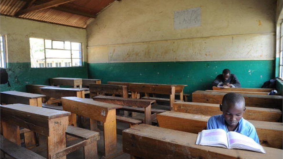 Pupils of the St. Paul Primary School in Nairobi sit in an empty classroom on January 26, 2009, after the school closed, entering its second week in a dispute about teacher's pay.