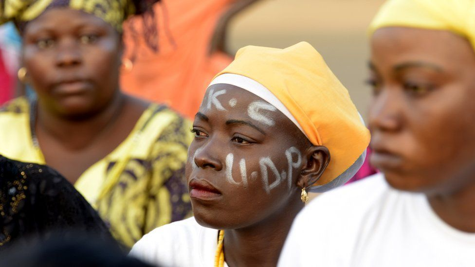 A supporter painted her face during a rally, in Banjul on April 4, 2017