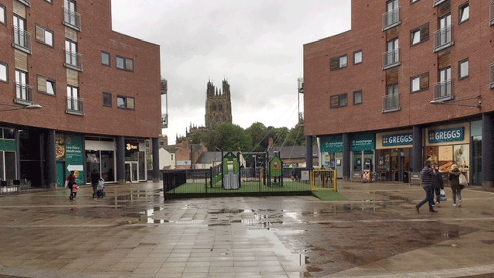 Looking towards Greggs shop and towards Wrexham's St Giles Church which overlooks Eagles Meadows