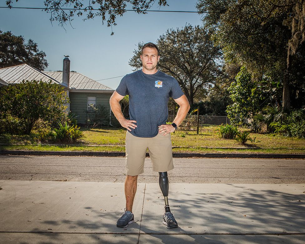 Justin Lansford standing on a pavement