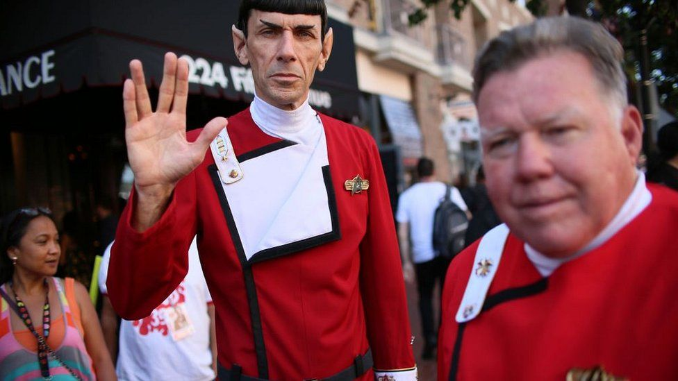Cosplay characters dressed as Mr Spock and Captain Kirk from Star Trek along 5th Ave. across from the San Diego Convention Center during Comic Con International in San Diego, California