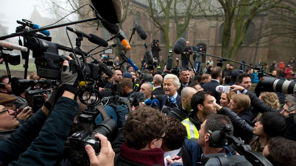 Firebrand anti-Islam lawmaker Geert Wilders, center, talks to the media during an election campaign stop in Spijkenisse, near Rotterdam, Netherlands, Saturday Feb. 18, 2017