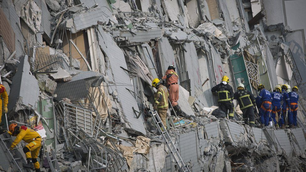 Rescuers search the collapsed building in Tainan, Taiwan, on 6 February 2016