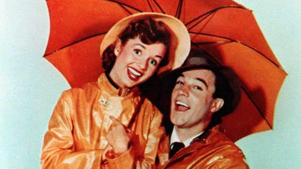 Photo of Gene Kelly and Debbie Reynolds in the 1952 film Singin' in the Rain