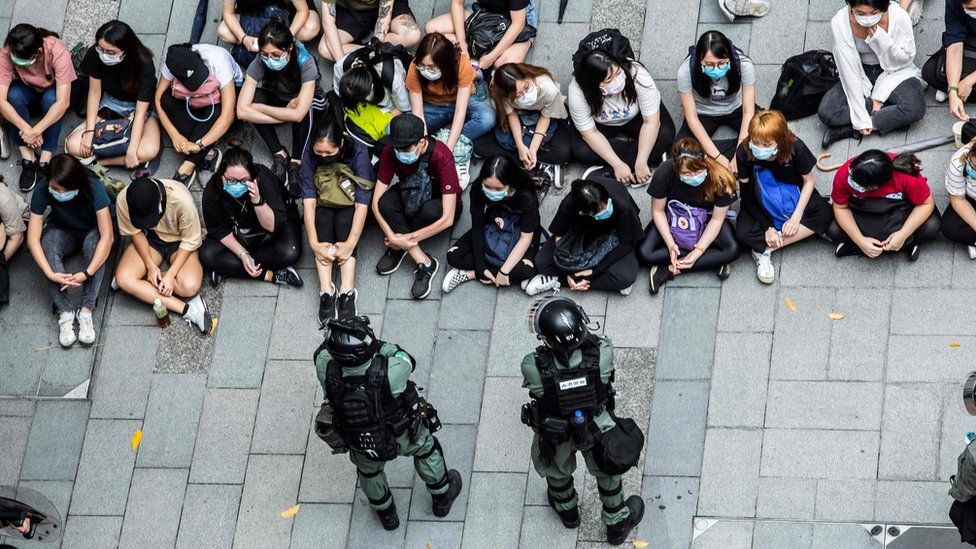 Riot police detain a group of people during a protest in the Causeway Bay district of Hong Kong