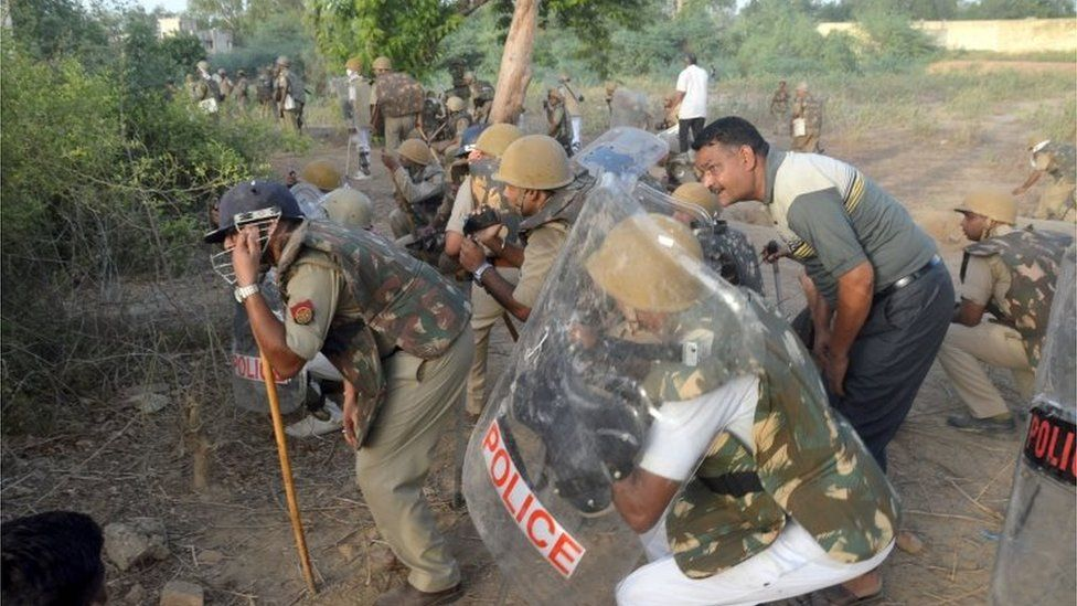 Indian police patrol during clashes with members of a sect said to have been living illegally at the Jawahar Bagh park in Mathura on June 2, 2016