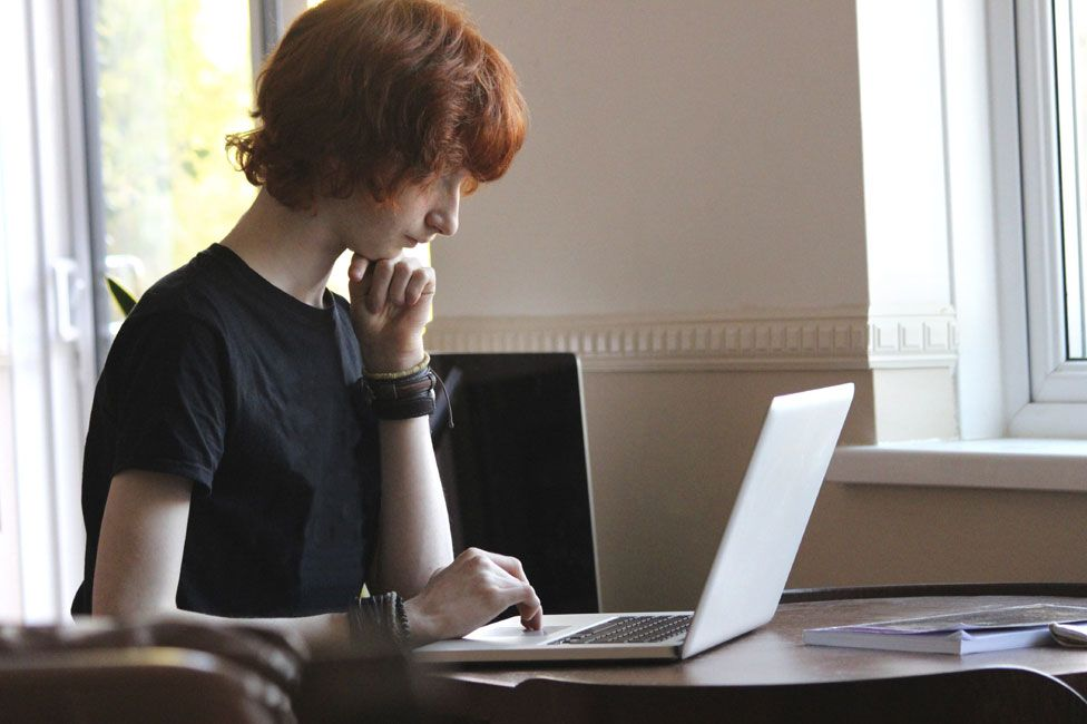 Young person with computer