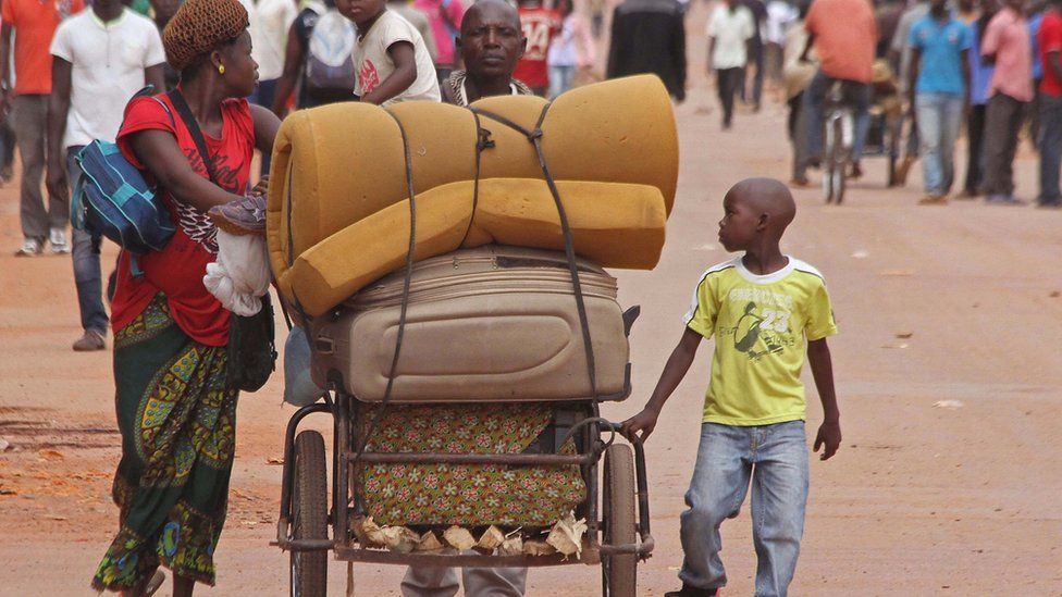A family with their belongings on a makeshift trolley in the city of Bangui, Central African Republic, Wednesday, 30 September 2015