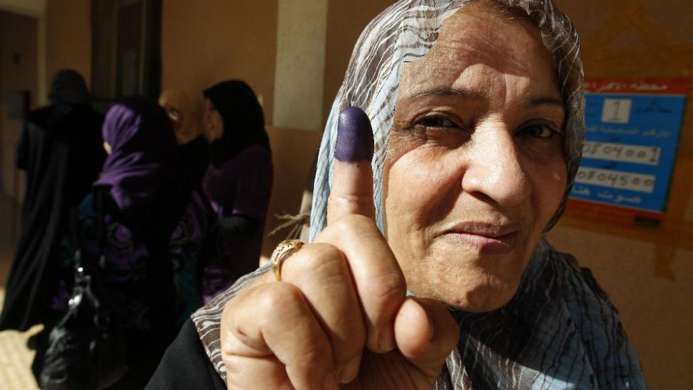 A Libyan woman shows her ink-stained finger after voting at a previous election in the eastern city of Benghazi.