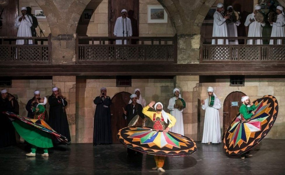 Egyptian dancers perform the Tanoura during the holy fasting month of Ramadan, at el-Ghuri culture Palace in Cairo on May 22, 2018.