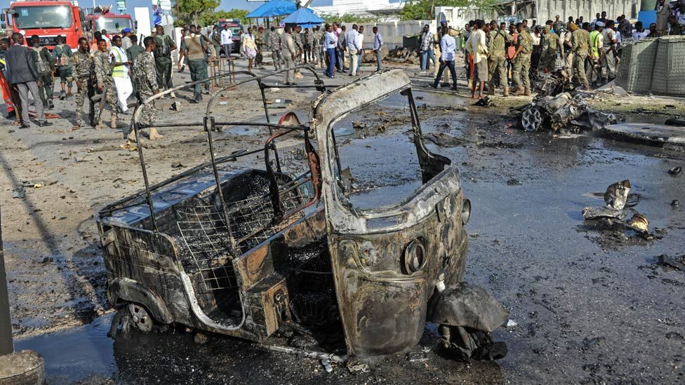 The wreckage of a vehicle is seen at the site of the car bomb explosion which killed at least four people outside of the Somali parliament in Modadishu on March 25, 2018