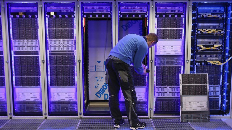 A man works in a data centre