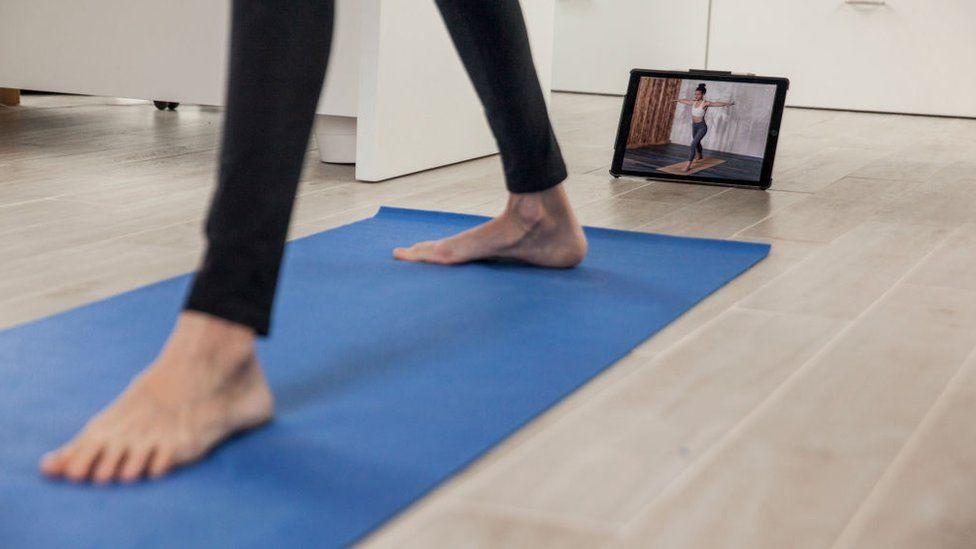 Yogi using a mat to do a workout