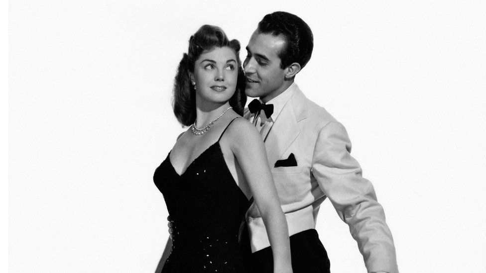 American actress and swimmer Esther Williams wearing a long evening dress and dancing with Mexican actress Ricardo Montalban in the film Neptune's Daughter, 1949