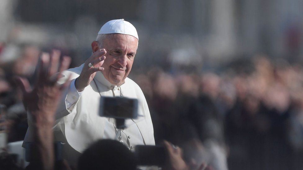 Pope Francis greets the crowd from the pope mobile after the celebration of a Mass marking the end of the Jubilee of Mercy, on 20 November 2016 at the Vatican.