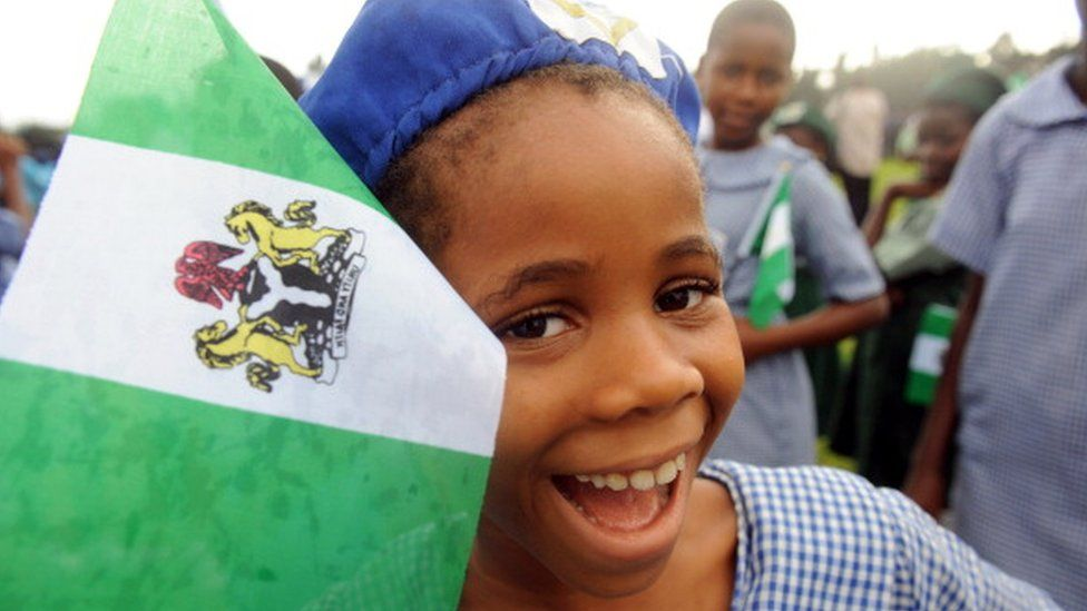 A Nigerian student smiles as she attends independence day celebrations in Lagos ion 1 October 2013