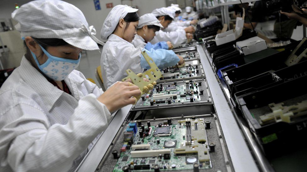 Chinese workers assemble electronic components at the Taiwanese technology giant Foxconn's factory in Shenzhen
