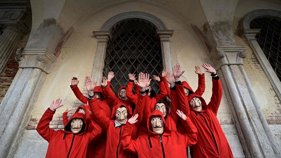 A group of revellers dressed as characters from Netflix's La Casa de Papel (Money Heist)
