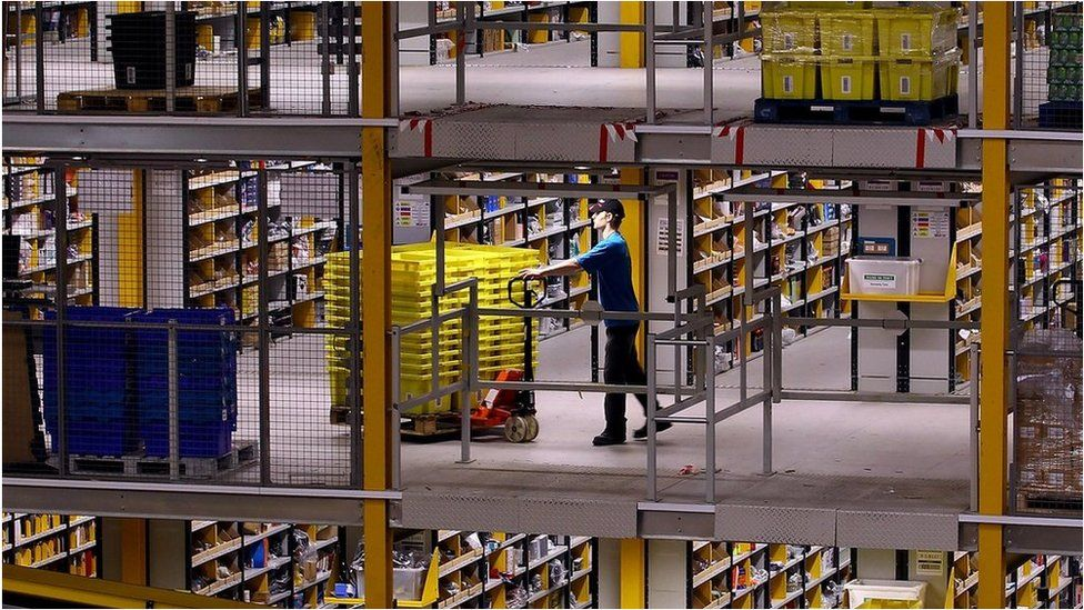A worker at Amazon's Swansea warehouse