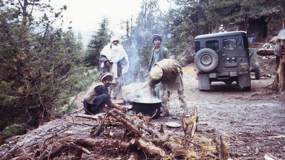 Men cooking over a fire