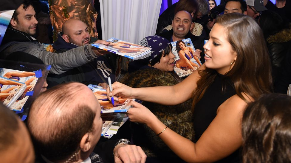 Ashley Graham signing copies of Sports Illustrated