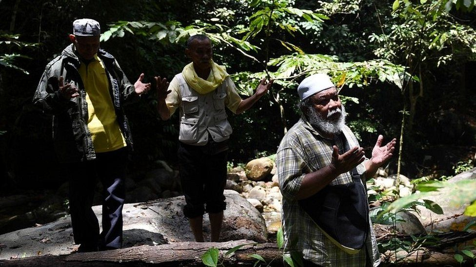 Shamans, known in Malaysia as bomoh, pray during the search effort