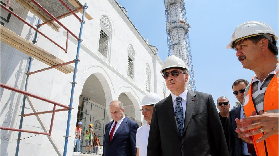 Turkish President Recep Tayyip Erdogan (C) visits the construction site of Ottoman Mosque in Ankara, Turkey on July 28, 2016