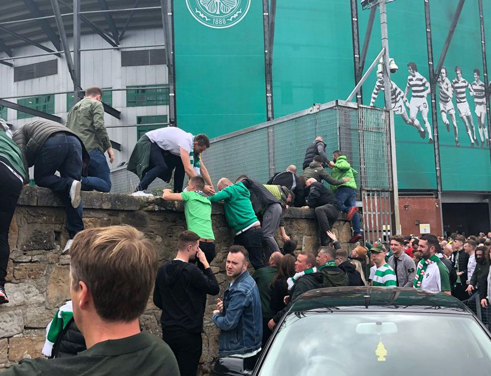 Fans climbing out of the ground