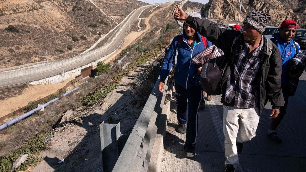 A group of migrants from poor Central American countries - mostly Hondurans - moving towards the United States are seen near the US border in Tijuana, Mexico