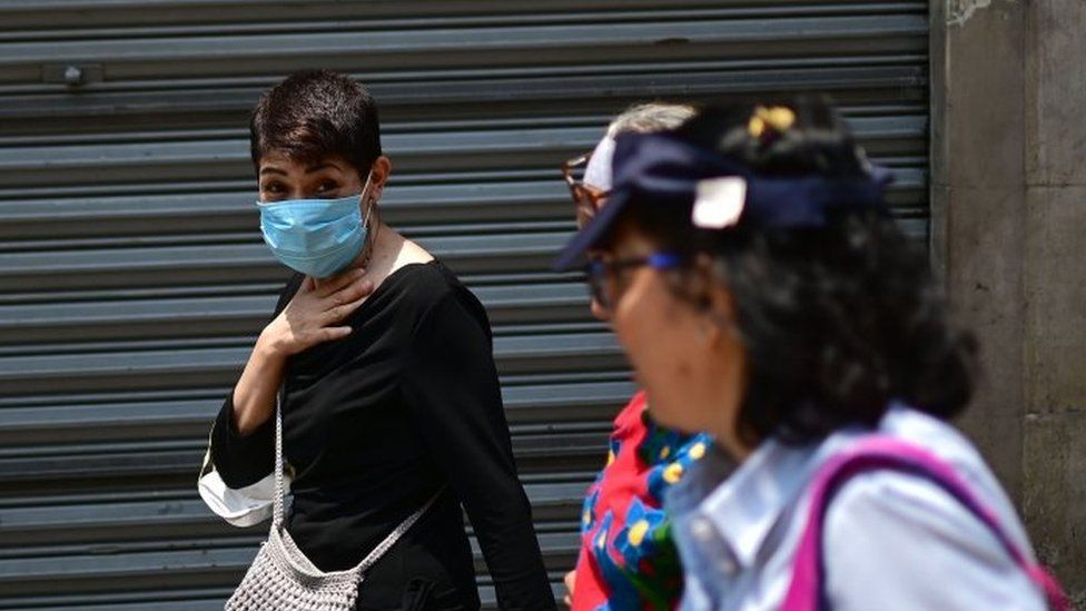 People wear face masks due to air pollution, in downtown Mexico City on May 14, 2019.