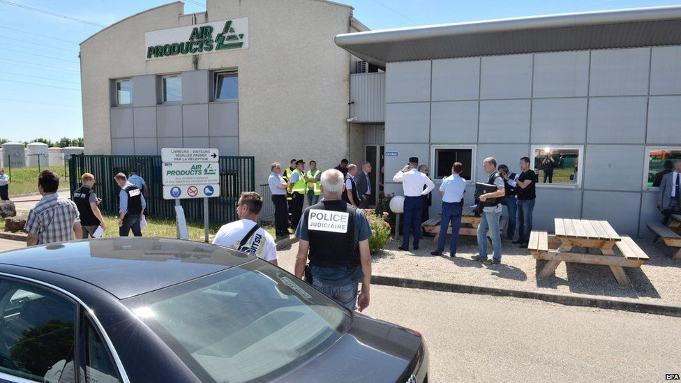 Handout photo of police investigators outside Air Products factory in Saint-Quentin-Fallavier, southeast of Lyon, on 26 June 2015