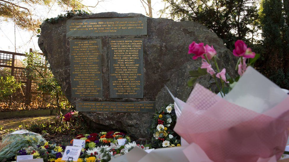 Flowers surround a memorial near St Andrew's Church