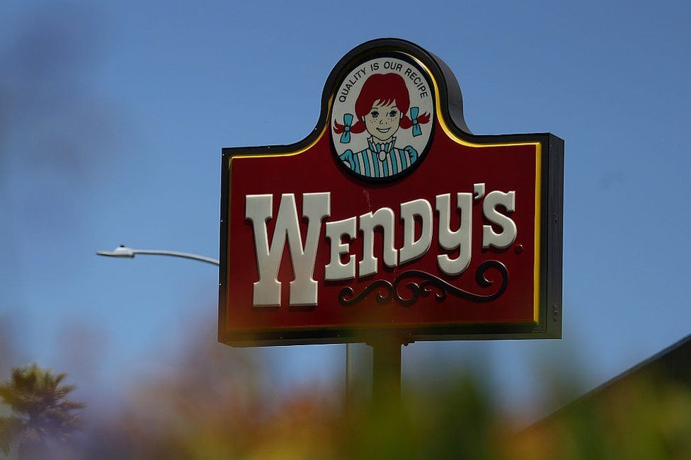 A sign for a Wendy's restaurant