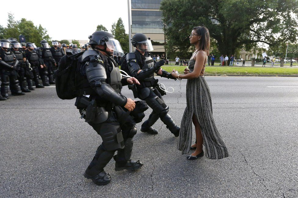 A demonstrator protesting the shooting death of Alton Sterling is detained by law enforcement near the headquarters of the Baton Rouge Police Department in Baton Rouge, Louisiana, USA, 9 July 2016.