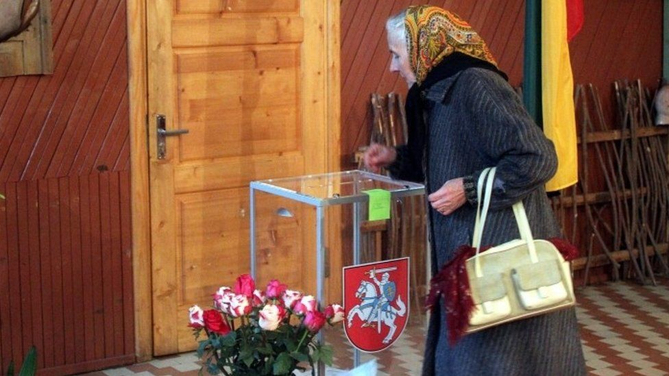 A woman voting during the second round of Lithuanian parliamentary election in Birzai, Lithuania (23 October 2016)