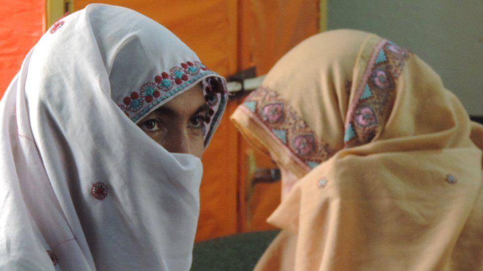 Zainab Bibi (left)