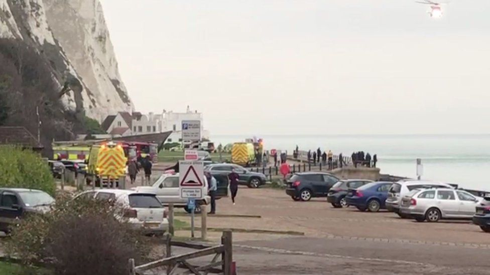 The man was airlifted to hospital after falling halfway down the cliff