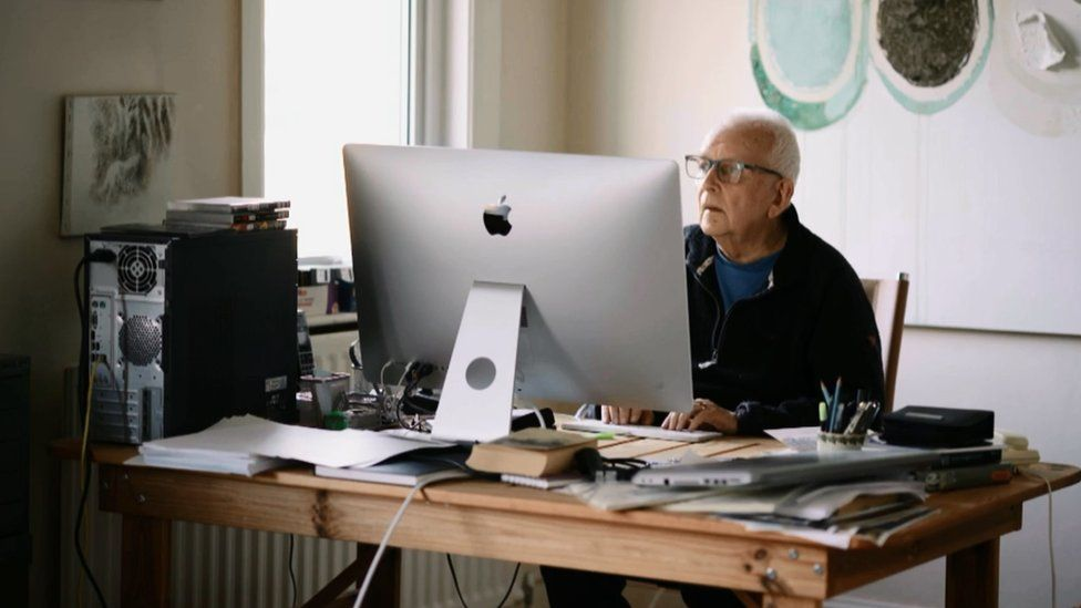 Andrew Davies at his computer working