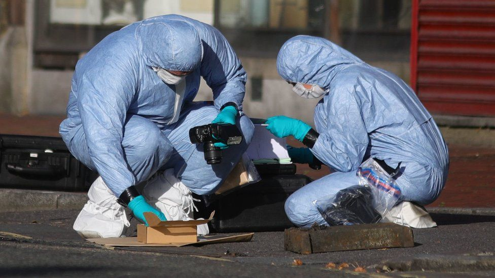 Forensic officers work near Forbury Gardens, in Reading town centre